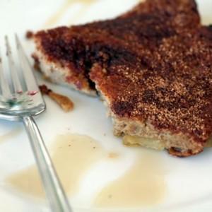 Half-eaten baked apple puff slice