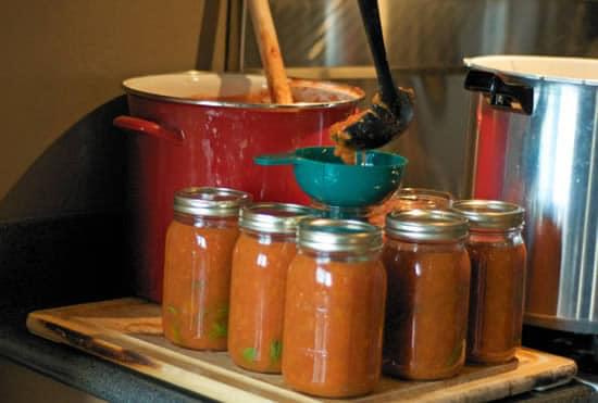 Ladling Tomatoes into Jars