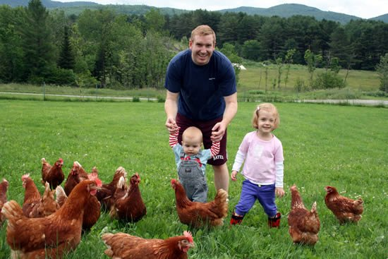 Jesse LaFlamme with Piper, Brock, and their hens