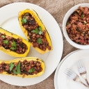 Stuffed Delicata Squash with Greens, Grains, and Beans