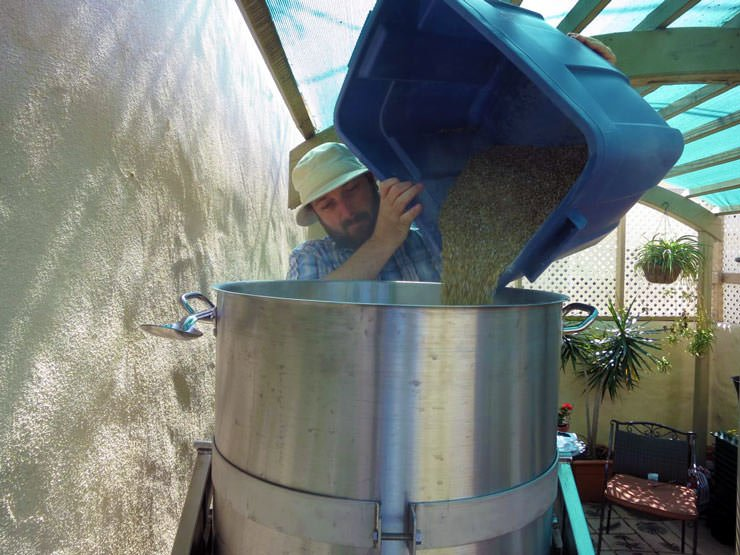 pouring grains into the mash tun