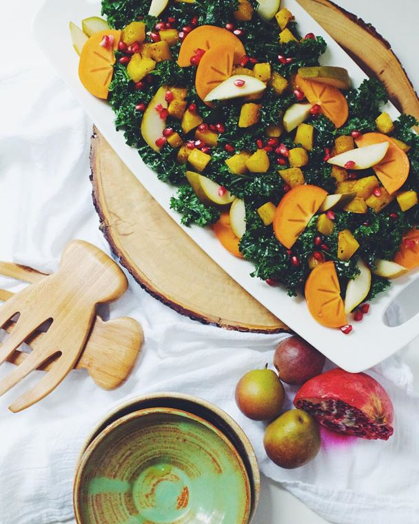 Garlicky Kale Persimmon Salad in a serving bowl
