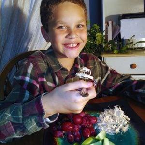 Kristi's son enjoying dinner